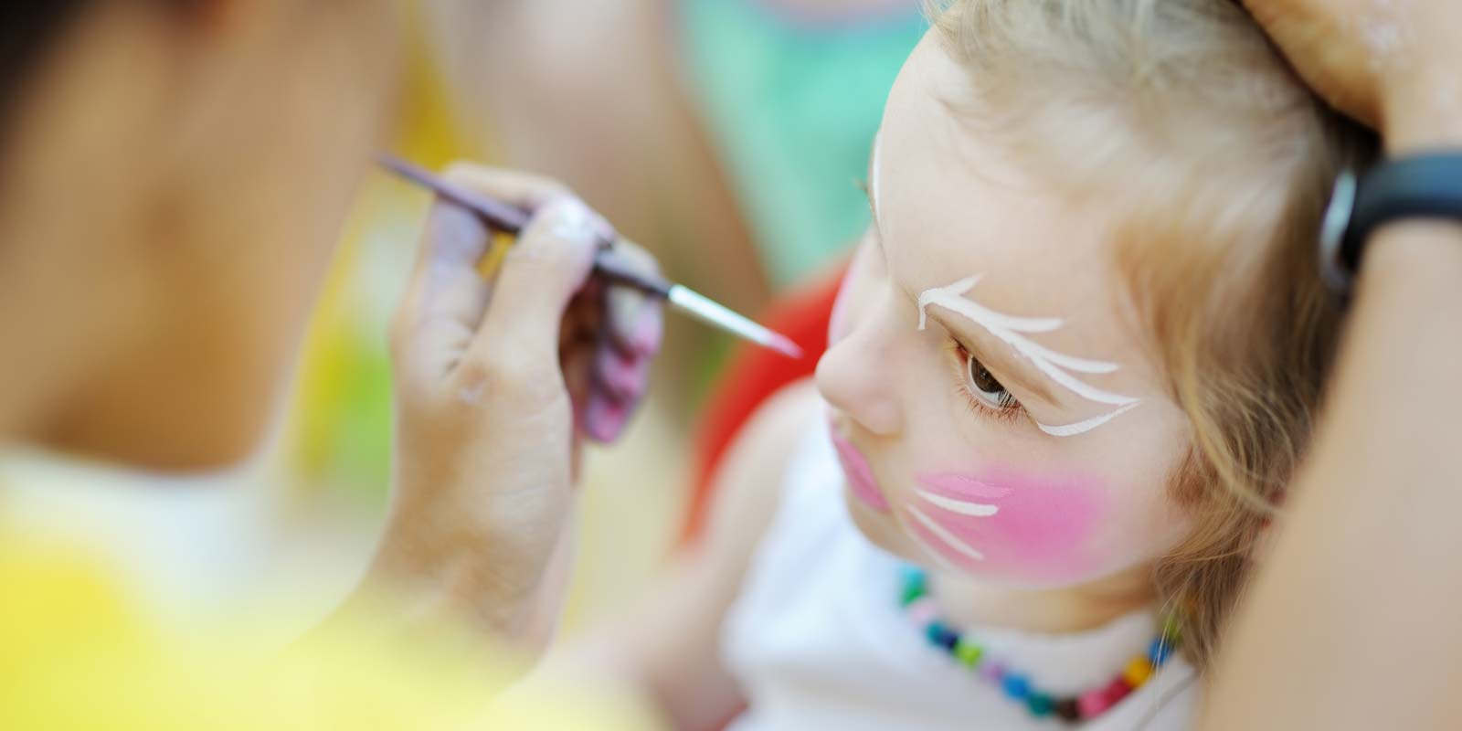 Little girl during a make-up workshop at the children's club at Le Bois Tordu 85 campsite